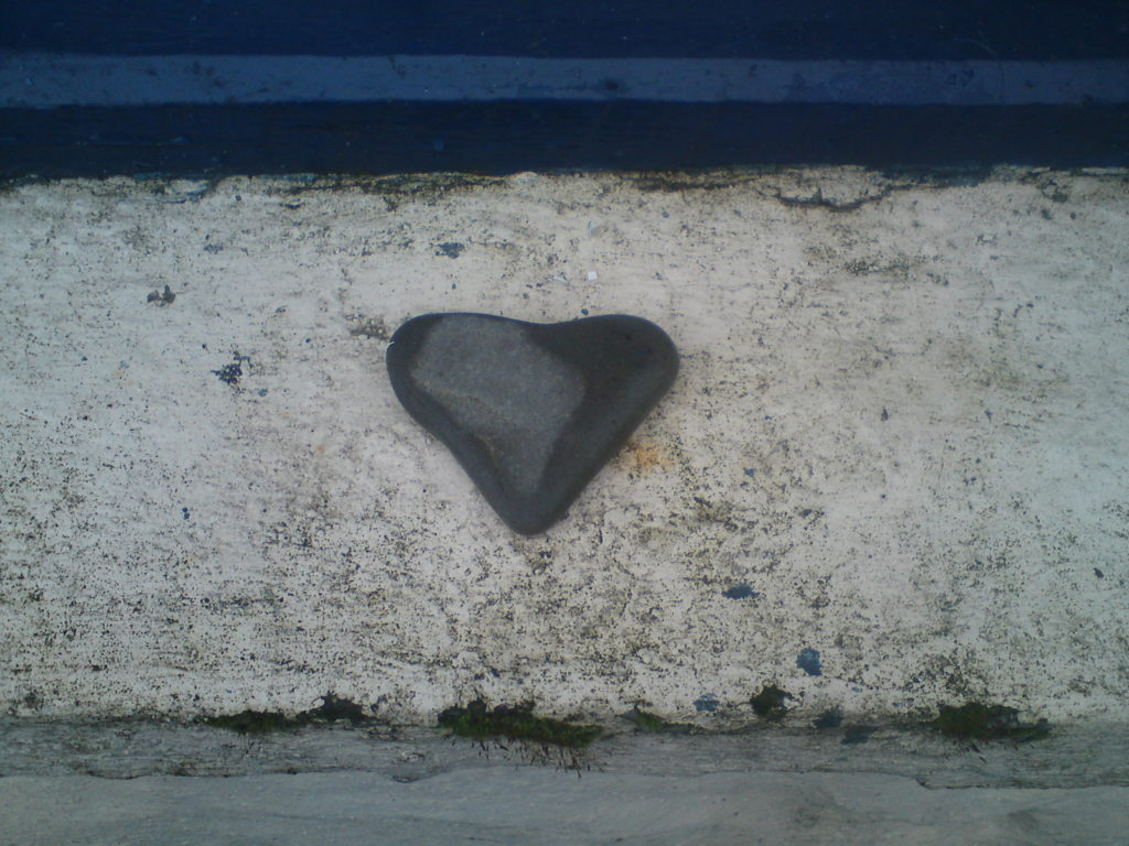 A heart shaped stone on a window cill to represent feelings